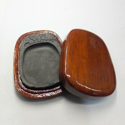 B528: Chinese calligraphy tool. Smallish sculptured ink stone with wooden case