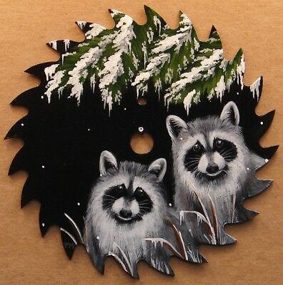Hand Painted Saw Blade Two Raccoons Evergreen Branches Snow