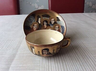 Japanese Satsuma Immortals Thousand Faces With Dragon Gilded Cup & Saucer