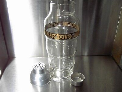 Cocktail shaker gold band mid century motif on fine glass tall skyscraper design