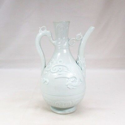 B479: Chinese pitcher of pale porcelain with appropriate work and tone