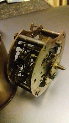 Antique / vintage Clock movement . Spare or repair poss marine Brass please look