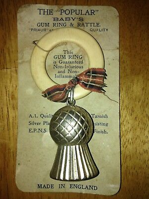 Antique thistle baby teething gum ring rattle on original card. Made in England.
