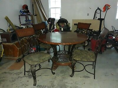Beautiful solid oak dining table with iron chairs...Exquisite!!