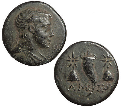 Ancient Greek bronze coin of Amisos. Winged head of Perseus.
