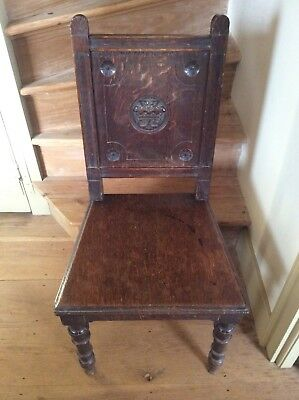victorian solid oak hall chair with carved crest on back panel C1870