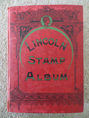 Old Lincoln stamp album from 1904 - plenty of old stamps