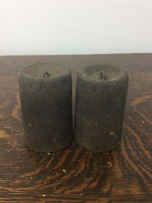 A pair of Antique Original Cast Iron American Wooden Works Clock Weights