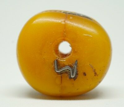 A Large Antique Amber Bead from the Sahara, with Silver Repairs