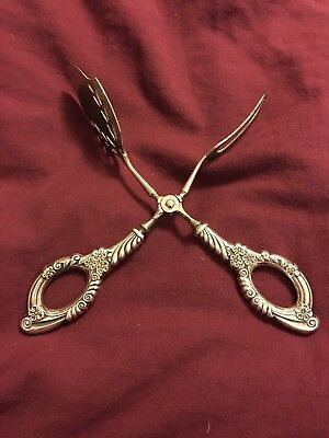 Marked Sterling silver pastry server scissors.