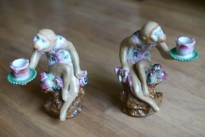 pair of antique chinoiserie porcelain painted monkey candlestick holders