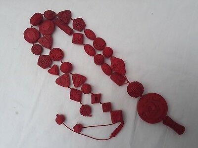 Vintage Chinese finely carved cinnabar necklace.
