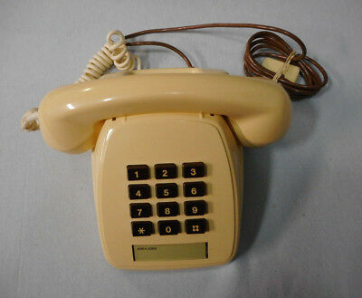 #Yy7.    Old Push Dial Telephone