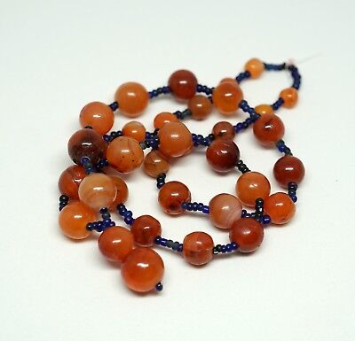 A Necklace of Ancient Carnelian and Indo-Pacific Glass Beads