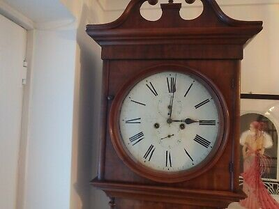 grandfather long case clock round face