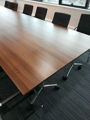 Large boardroom table (2 parts). Dark wood with chrome legs. Originally £2,068.