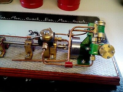 vintage marine v2 steam engine with shaft and propeller with f/r