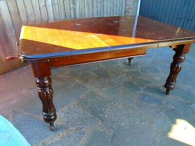 antique original victorian mahogany wind-out dining table.