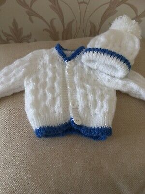 Hand Knitted Newborn White Cardigan With Matching Hat Edged In Royal Blue