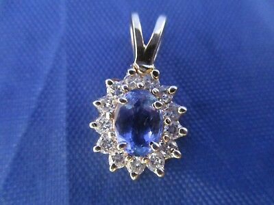Vintage 14K Yellow Gold and Blue Stone and Diamond Pendent.      (TESTED 14K)