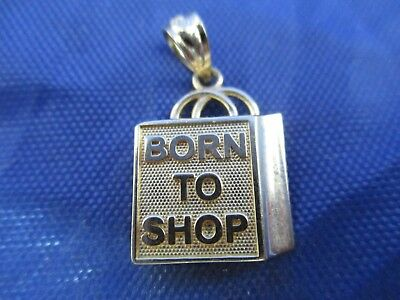 Vintage 14K Yellow Gold Born To Shop Pendent.      (MARKED 14K)