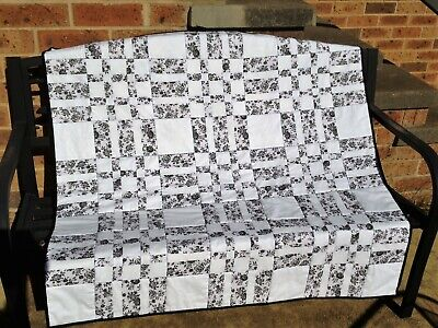Handmade Patchwork Lap Quilt. Black and white print.