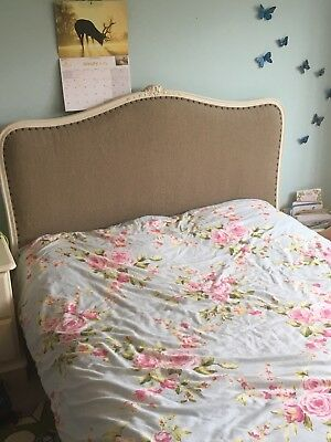 Vintage French Louis XV double bed with new upholstery and wooden slats.