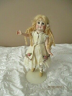 Beautiful Reproduction Jointed Bisque Doll 8 inches in Height Fully Dressed