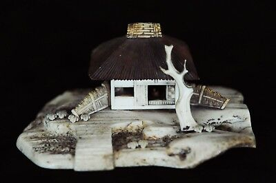 Japanese hand-carved bovine bone sculpture of a home and its environs - detailed