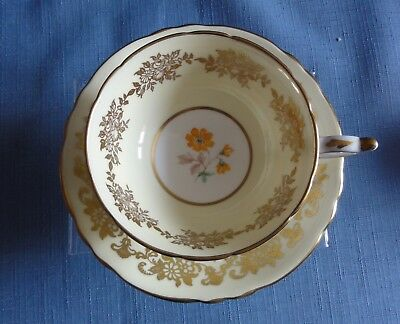 PARAGON Yellow & Gold with floral design Cup & Saucer Made in England