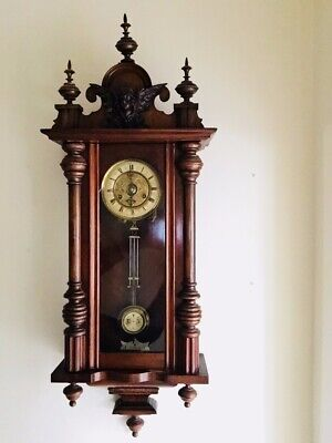 Antique Vienna chiming wall clock in dark wood. Good condition.