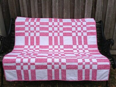 Handmade Patchwork Lap Quilt. Pink and white print.