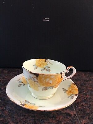 Aynsley mint green tea cup and saucer with yellow cabbage roses England Pretty