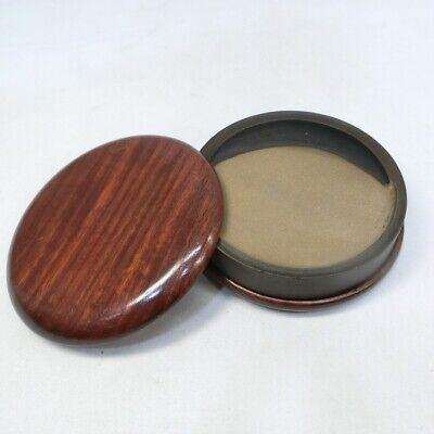 E221: Chinese calligraphy tools. An ink stone of round shape with KARAKI case.
