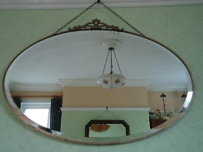Vintage Art Deco Brass Framed Oval Beveled Edge Wall Mirror with Crest and Chain