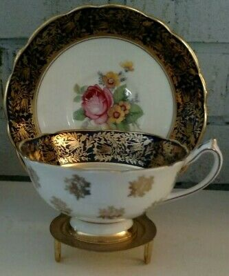 Rare Paragon Blue Tea Cup & Saucer Large Pink Roses Gold Medallions on Outside