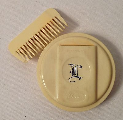 "Cream celluloid initialed ""L"" Fuller compact w/ sleeved comb circa early 1900s"