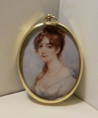 Miniature portrait of red haired woman in an oval brass bezel