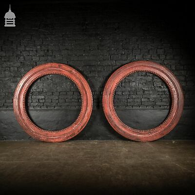 Pair of Vintage Carved Hardwood Round Window Frames with Distressed Red Paint