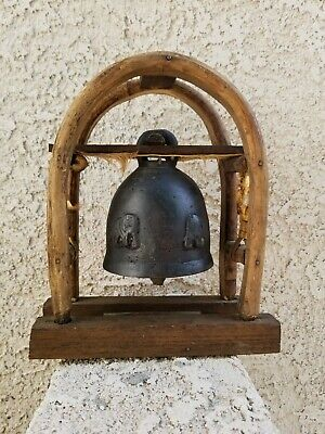 Vintage bronze Thailand Bell with Elephant Artwork Hanging On Bamboo wood Stand