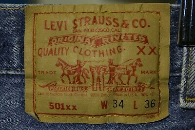 ba16270e486 Levis 501 Button Fly 80s Red Tag Made in USA Vintage Faded Denim Jeans  32x32 Tab