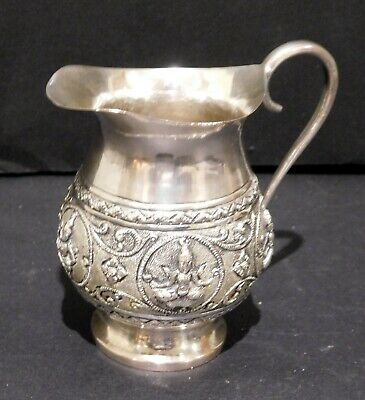 Indian Solid Silver Jug with Deities.   76 Grams
