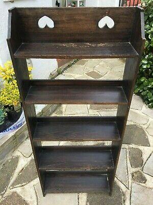 Antique Liberty style Arts and Crafts open bookcase fretwork hearts design, worn