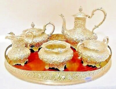 A magnificent repousse sterling tea & coffee service, Jacobi & Jenkins, Baltimor