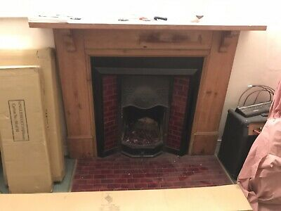 Victorian cast iron fireplace surround with tiles and wooden surround