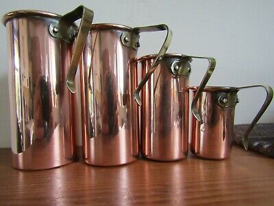 Arts and Crafts copper / tin lined baking measures, 1 cup to 1/4 cup. ( stacking