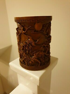 Intricately carved Chinese wooden brush pot depicting cranes and trees