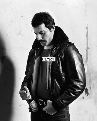 Freddie Mercury of the Rock Band Queen Poses for a Portrait with a Beer Photo
