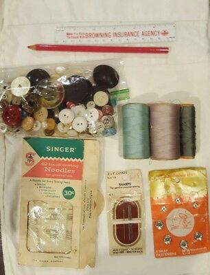 Vintage sewing notions including buttons,  needles,  snaps, ruler thread