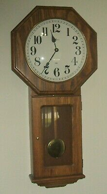 Howard Miller Tall Oak Schoolhouse Style Wall Clock with New Dual Chime Movement